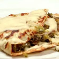 Ham, leek and mushroom crêpes with Parmesan cheese sauce