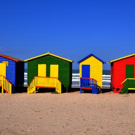 Muizenberg Beach by Lennon Fletcher - Landscapes Beaches ( sand, blue sky, colors, bathing box, sea, beach, red green yellow blue )