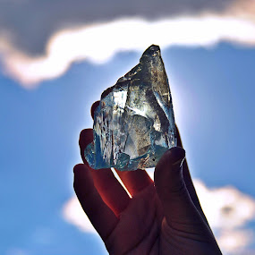 In Hand by Charles Shope - Artistic Objects Glass ( clouds, hand, natural light, sky, color, artistic, glass, stone, sun,  )
