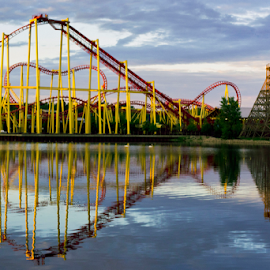 Thunderhawk Reflections by Dave Skorupski - City,  Street & Park  Amusement Parks ( clouds, ride, water, reflection, amusement park, waterscape, coaster, roller coaster, reflections, yellow, roller, ponds, red, rides, amusement, amusement ride, metal, amusement parks, cloudy, cloud, pond,  )