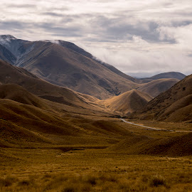 Lindiss Pass , NZ by Patto Nikonian - Landscapes Mountains & Hills ( field, cloud forming, sky, mountain, big mountain, road, new zealand )