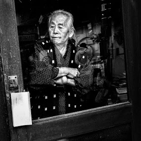 Shopkeeper by Kurt K Gledhill - City,  Street & Park  Street Scenes ( okayama, japan, monochrome, street, white, candid, place, people, black )