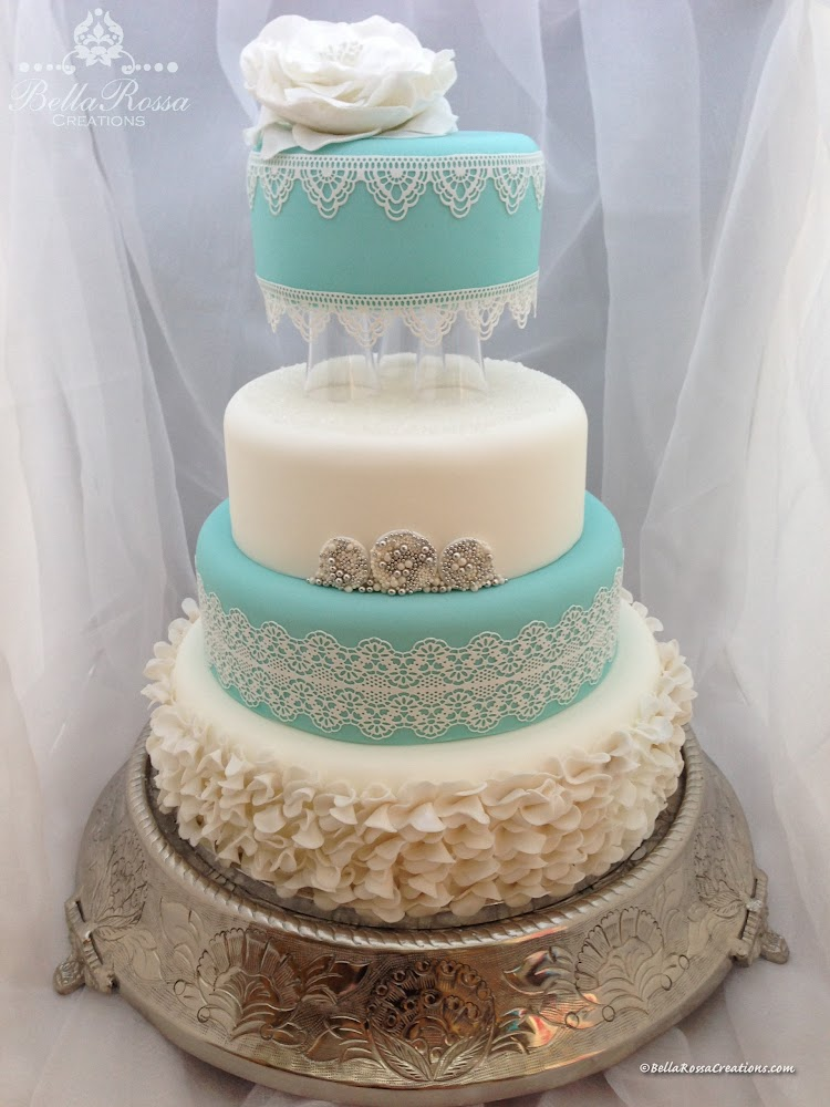 4-tier Lace Wedding Cake. Each tier consisted of different flavours. The bottom tier was decorated with gum paste ruffles, the 2nd and top tier were surrounded with sugar lace using
