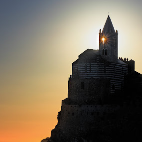UNCONVENTIONAL LIGHTHOUSE by Paolo Lazzarotti - Landscapes Waterscapes ( backlit, spikes, lighthouse, star, bell tower, chapel, seascape, blue and orange sky, fisherman, boat, portovenere, sun )
