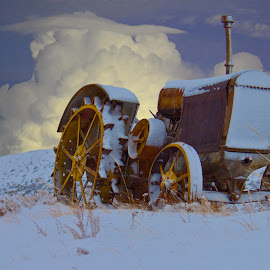 Vintage tractor by Greg Harcharik - Transportation Other ( winter, wyoming gillette intersrate, tractor )