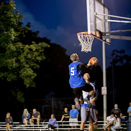 A local community basketball game. by Cary Chu - News & Events Sports