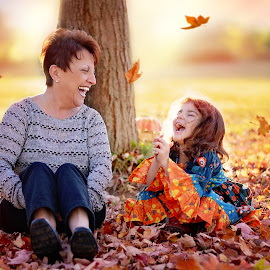Share a laugh by Darya Morreale - People Family ( laughing, girl, family, falling leaves, grandmother )