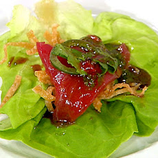 Fresh Tuna and Butter Lettuce Wraps with Crispy Wonton Threads, Shaved Jalapeno and Basil Oil