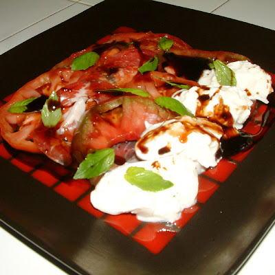 Locally Grown Heirloom Tomato Salad with Fresh Burrata Cheese and Coppa.