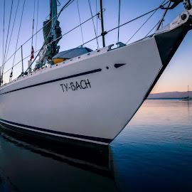 Becalmed by Rob Germain - Transportation Boats ( calm, magic hour, ocean, bow, sailboat,  )