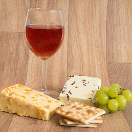 Rose wine with cheese and crackers by The Newborn Studio Sussex - Food & Drink Meats & Cheeses ( wine, rose, wine glass, rose wine, cheese and crackers, crackers, cheese, white grapes )