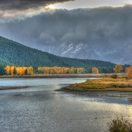 Winter Rolls Into The Tetons by Levi Oelrich - Landscapes Weather ( mountains, autumn, fall, wyoming, lakes, ducks, yellow, tetons, alpine,  )