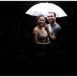 Taken in the storm after 4th July Fireworks by Nandish Desai - People Couples