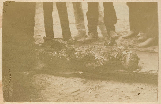 One of the burnt bodies of either Dan Kelly or Steve Hart following the fire of the Glenrowan Inn.
