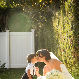 True love's kiss by Elijah Vicente  - Wedding Bride ( mother and son )