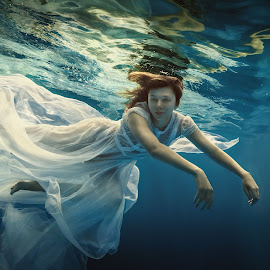 Fluff. by Dmitry Laudin - People Fashion ( girl, lightness, blue, underwater, dress, white, feather, swimming )