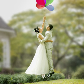 flying with balloons by Ko Naing - People Couples