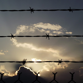 Shining Through by Helen Jamison - Landscapes Cloud Formations ( clouds, sunset, beautiful, barbed wire, golden )