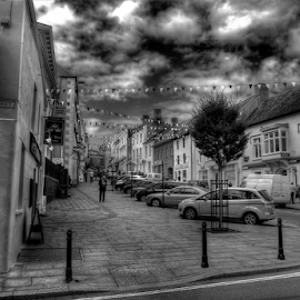 High Street by Simon Eastop - City,  Street & Park  Street Scenes ( sttreet, corner, shops, pembrokeshire, people, haverfrodwest )