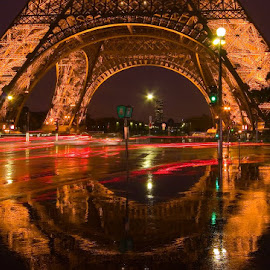 Eiffel Tower with traffic trails at dusk in the rain. by Gale Perry - Buildings & Architecture Public & Historical