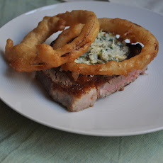 Rib-Eye Steak with Blue Cheese Butter and Fried Onion Rings