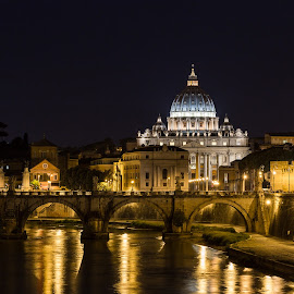 Basilica Papale di San Pietro in Vaticano by Pierre Bo - Buildings & Architecture Public & Historical ( water, reflection, europe, architectural element, dome, bikeway, yellow, shade of yellow, shade of blue, religious structure, basilica di san pietro, street light, sky blue, lighting, blue, rome, column, long exposure, night, pillar, bridge, italy, travel photography, river )