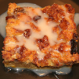 Bread Pudding With Disaronno Sauce by Waynette  Townsend - Food & Drink Candy & Dessert ( plated, sweet, bread pudding, raisins, dessert,  )