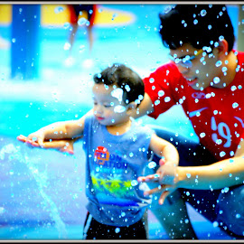 Playing with water by Chin KK - City,  Street & Park  Amusement Parks ( river safari; zoo; daytime; child; father; water )