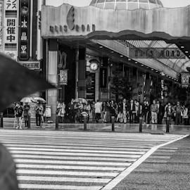 Waiting under shelter by Anthony Weber - City,  Street & Park  Street Scenes ( crossing, shopping street, japan, waiting, umbrella, street, sendai, red light, rain, ichibancho )