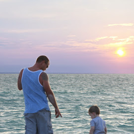 father and son stroll on the beach by Erika Ramsay - Novices Only Street & Candid ( water, sand, dad, sunset, son, candid, beach, toddler )