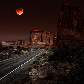 Courthouse Rd Eclipsed by Carl Clay - Landscapes Caves & Formations ( couthouse, desert, arches national park, utah, formations, landscapes, rocks, roadway )