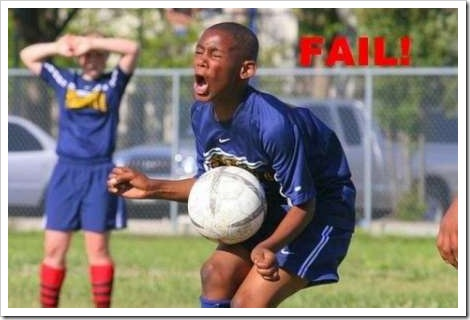 Funny soccer picture - Kid gets ball in stomach.