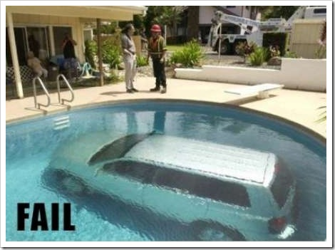Funny car picture - Car inside pool.