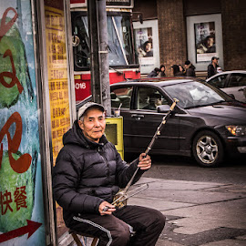Erhu Player by Roy Morra - City,  Street & Park  Street Scenes ( sony, urban, toronto, chinatown, street, spadina, erhu, slt a37, chinese, downtown )