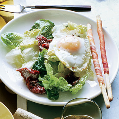 Fried-Egg Caesar with Sun-Dried Tomatoes and Prosciutto Breadsticks