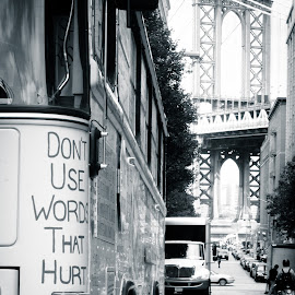 No Dumb Words in DUMBO by Lemuel Ayudtud - City,  Street & Park  Street Scenes ( black and white, street, dumbo, transportation, new york, nyc, photography, city, cobble stones, urban, manhattan bridge, lifestyle, onemilliionactsofkindness, streets, bridge, new york city, brooklyn,  )