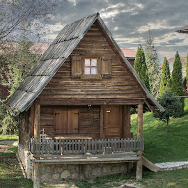 A wooden cottage at the lake by Milos Vasic - Buildings & Architecture Homes ( wooden, nature, green, cottage, peace, lake, boat,  )