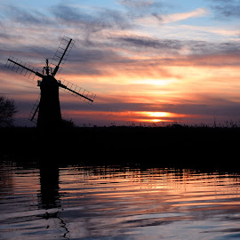 Turf Fen Mill Sunset by Kevin Myhill - Landscapes Sunsets & Sunrises ( clouds, mill, mills, silhouette, ripples, sunset, rivers,  )