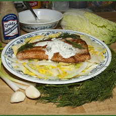 Salmon With a Creamy Sauce on a Bed of Greens