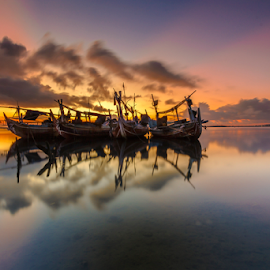 Waiting by Choky Ochtavian Watulingas - Landscapes Sunsets & Sunrises ( clouds, reflections, ships, sunrise, seascape, sun rays, rays )