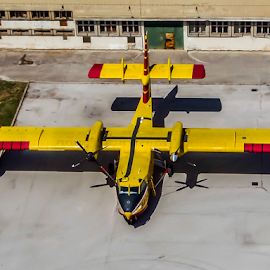 Parking by Darko Maretić - Transportation Airplanes ( water, firefighter, wings, airplane, aircraft, firefighters, cl, yellow, miitary, canadair,  )