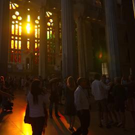 Sun shining through a church window by Dotan Naveh - Buildings & Architecture Places of Worship ( organge, window, church, sunset, dramatic, people, sun )