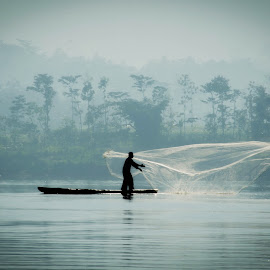Fisherman in Action by Yakkup Fauzan - Nature Up Close Water