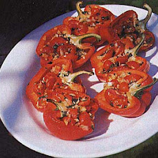 Roasted Peppers Stuffed with Cherry Tomatoes, Onion, and Basil