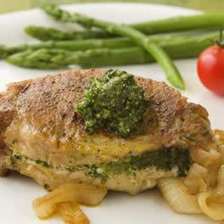 Pesto-Stuffed Pork Chops with Caramelized Onions