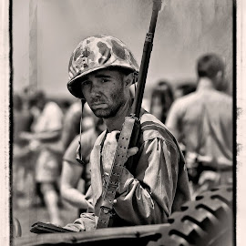 Thanks to Ricardo von Puttkammer here is day 1 of BW Challenge.  Most who know me will acknowledge I am a passionate history enthusiast.  As part of the Commemorative Air Force: Dixie Wing I participate in one of the largest WWII re-enactments/living history exhibition events annually.  Much work and devotion go into making the event memorable.  And of course, the re-enactors add a vivid, visual dimension that demonstrate the realness of history.  Kudos to Kelly's Zeroes and one of my favorite models for pics, Carey Michael Woodall here in a scene from 2014.  Come join us in 2015! I now nominate David Sodko for the challenge! by Pam Ellis - News & Events Entertainment