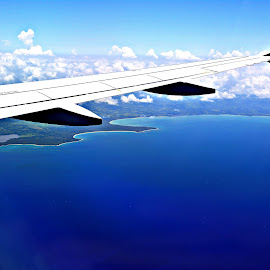 Flying into Dominican Republic by Tonja Wolfe-Throgmorton - Landscapes Travel