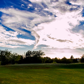 Behind my apartment by Brian Biggs - Landscapes Prairies, Meadows & Fields ( clouds, sky, oklahoma, norman, fields )
