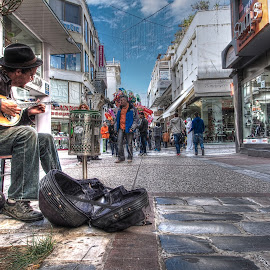 by Simon Gaitanidis - People Musicians & Entertainers
