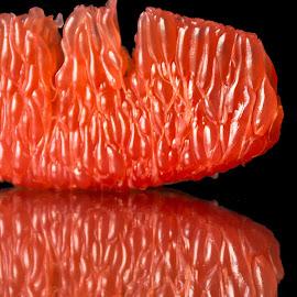 Grapefruit #2 by David Kreutzer - Food & Drink Fruits & Vegetables ( fruit, red, ruby red, citrus, fresh, pink, dark background, freshness, grapefruit )